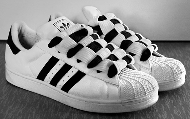 White Adidas Superstars with black trim and black & white Checkerboard Lacing (from Tuomo L)