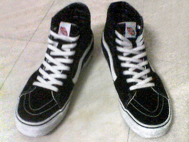 Black Vans Sk8 Hi shoes with white trim and white Display Shoe Lacing (from Earvin A)