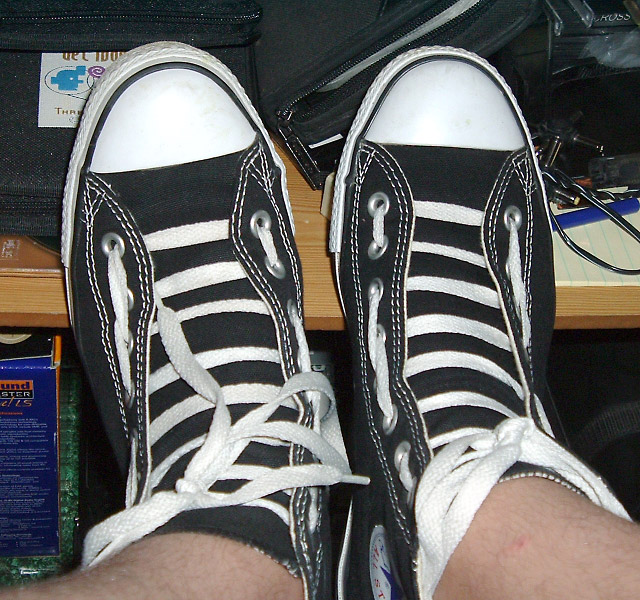 Black Converse low-tops with white trim and white Hiking / Biking Lacing (from Dilly)