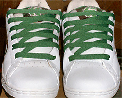 White Etnies Callicuts with camouflage trim and green Sawtooth Lacing (from Bridgette L)