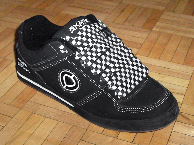 Black skate shoes with white trim and checkered Straight Bar Lacing (from Grigory K)