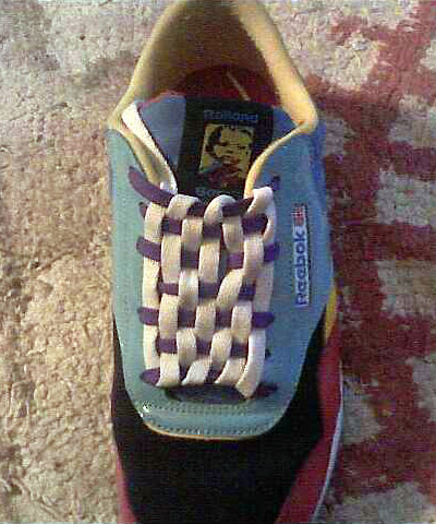 Multi-colored Reebok sneakers with purple & white Checkerboard Lacing (from Coy B)