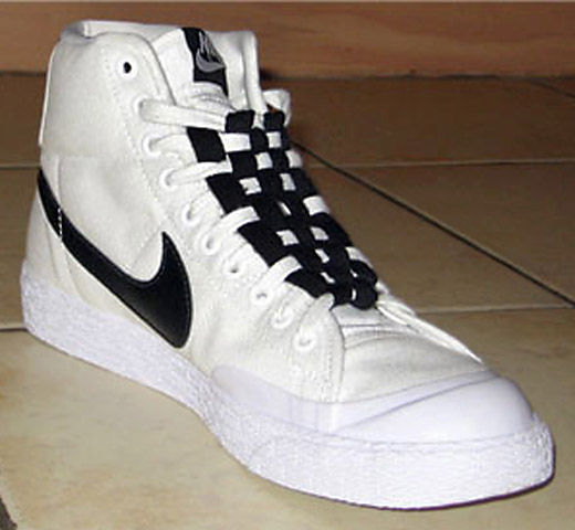 White Nike sneakers with black trim and black & white Checkerboard Lacing (from Kev)