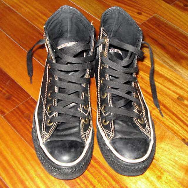 Black Converse All-Stars with white trim and black Double Helix Lacing (from Lee)