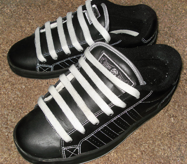 Black Osiris shoes with silver trim and white Hidden Knot Lacing (from Yoana G)
