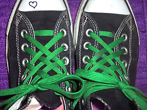 Black Converse sneakers with white trim and green Lattice Lacing (from Kat)