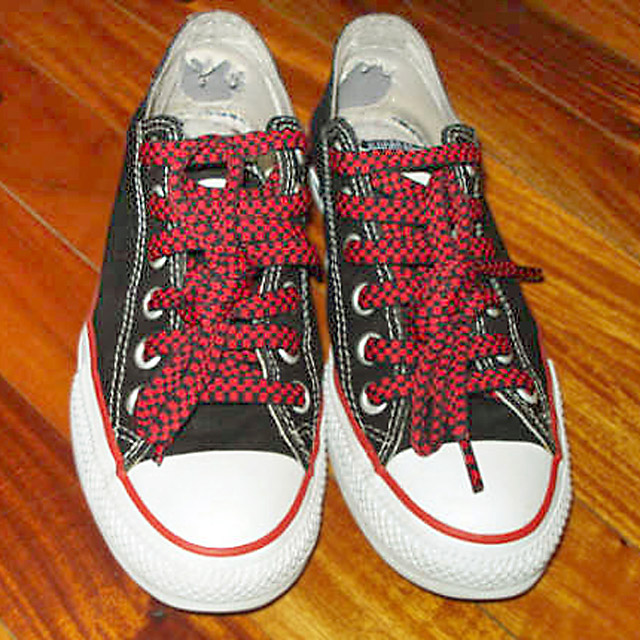 Black Converse All-Stars with red & white trim and checkered red & black Riding Boot Lacing (from Lee)