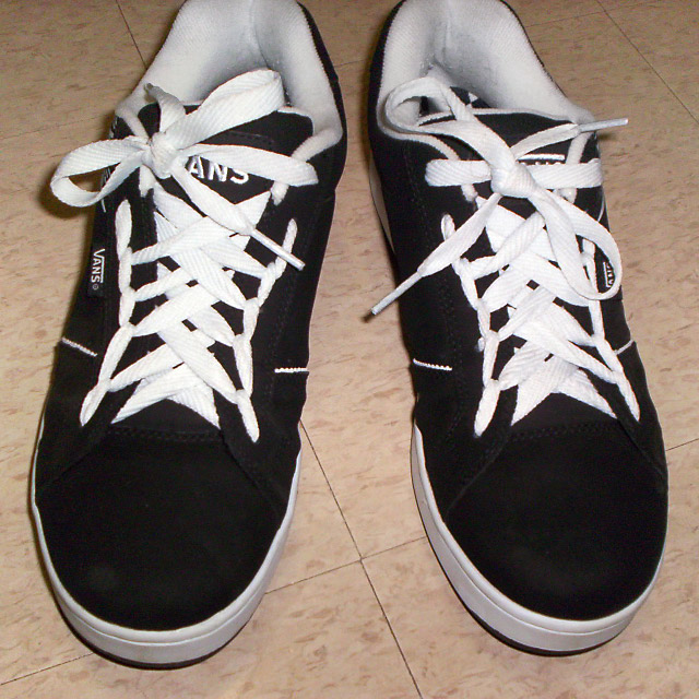Black Vans sneakers with white trim and white Spider Web Lacing (from Craig M)