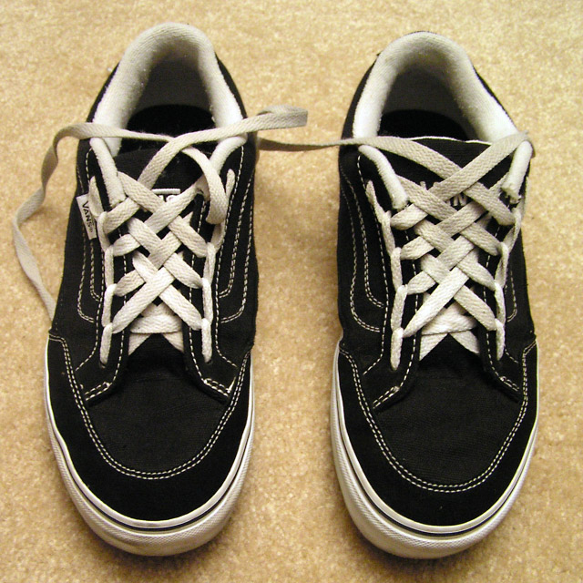 Black Vans sneakers with white trim and white Spider Web Lacing (from Sean)