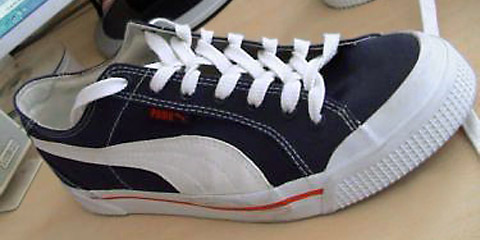 Navy blue Puma sneakers with white & red trim and white Zipper Lacing (from ???)