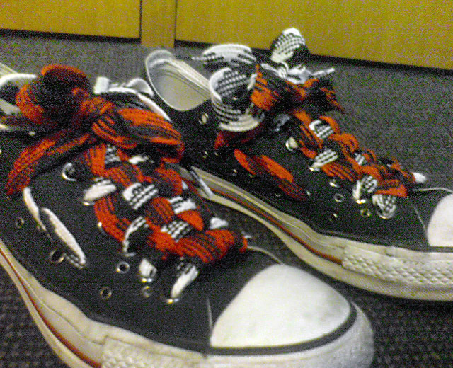 Black Converse sneakers with white trim and patterned red, white & black Checkerboard Lacing (from Ray F)