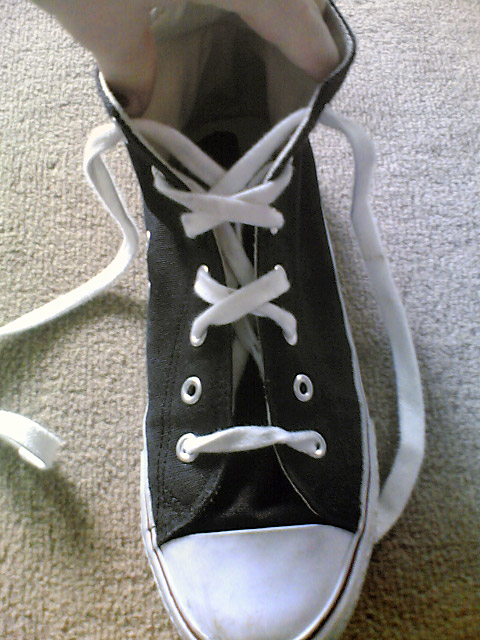 Black Converse hi-tops with white trim and white Double Cross Lacing (from Jessica D)