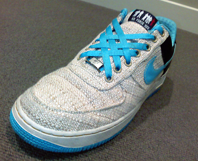 Cream Nike Air Force Ones with cyan & black trim and cyan Lattice Lacing (from Ryan C)