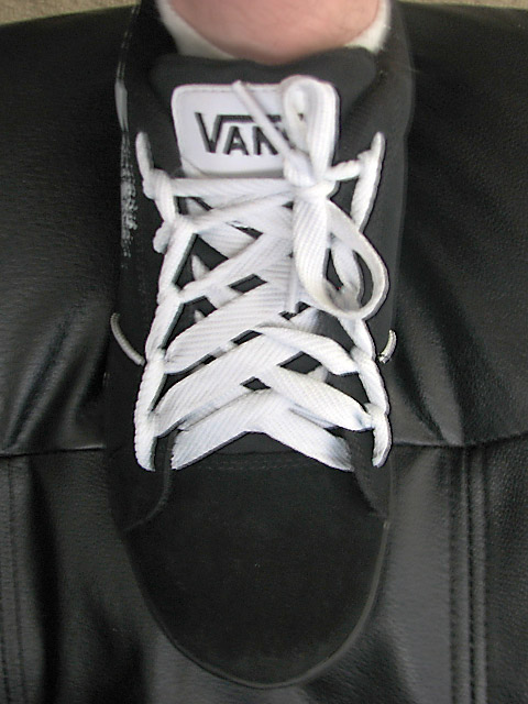 Black Vans sneakers with white trim and white Spider Web Lacing (from Ben)