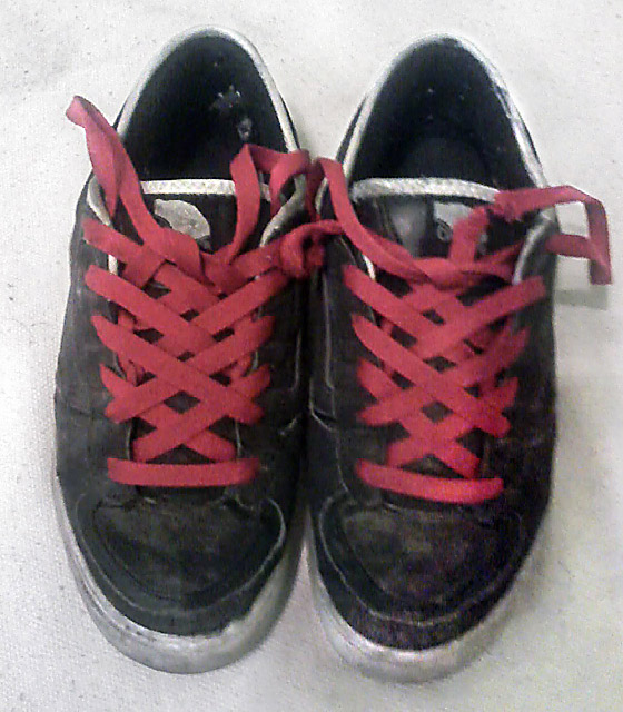 Black Vans sneakers with white trim and red Spider Web Lacing (from Martin N)