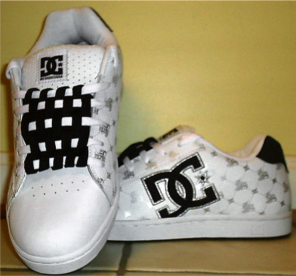 White DC sneakers with patterned silver & black trim and black & white Checkerboard Lacing (from Justin T)