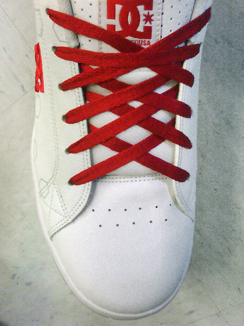 White DC sneakers with red trim and red Double Back Lacing (from Austin W)