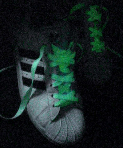 White Adidas Superstar IIs with black trim and glow-in-the-dark Over Under Lacing (from Ray F)