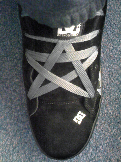 Black DC sneakers with white trim and grey Pentagram Lacing (from Martin M)