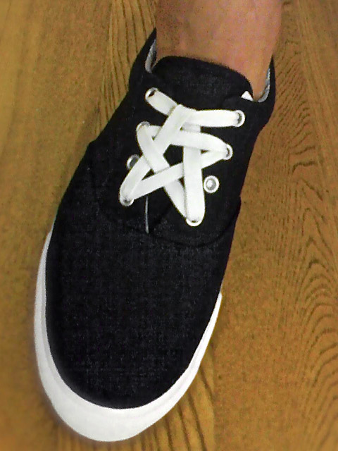 Black sneakers with white trim and white Pentagram Lacing (from Ron)