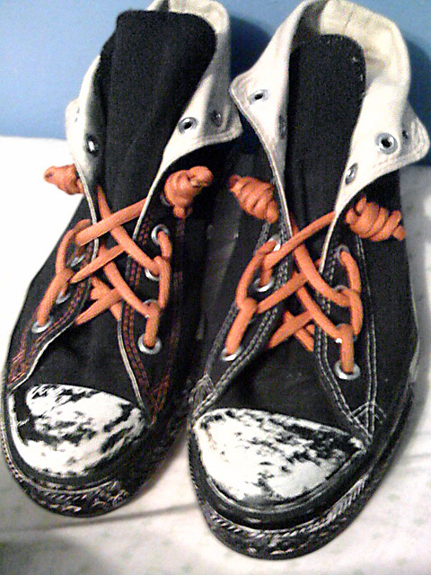Black Converse Hi-Tops with white trim and orange Spider Web Lacing (from Jess)