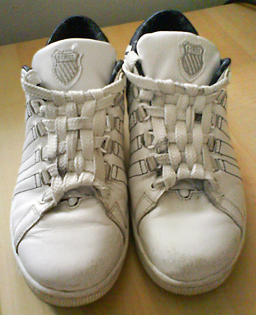 White K-Swiss sneakers with black trim and white Checkerboard Lacing (from Judy)