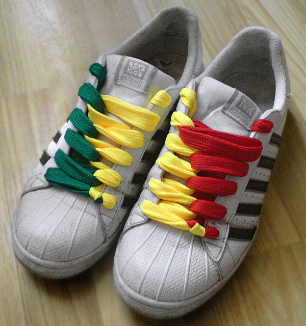 White sneakers with black trim and green, yellow & red combination of Half & Half Lacing and Loop Back Lacing (from Piotrek R)