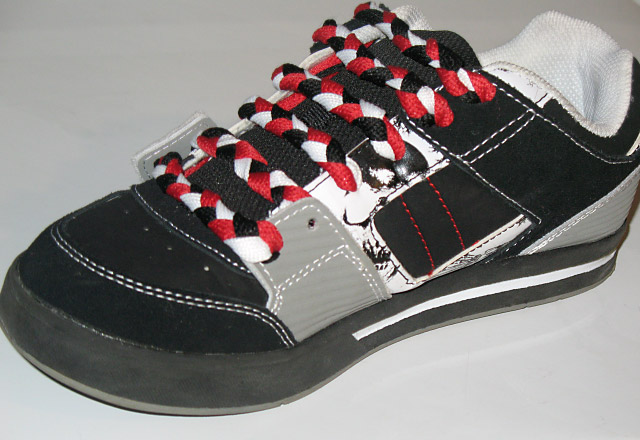 Black & grey sneakers with white trim and red, white & black Straight Bar Lacing (from Norman D)