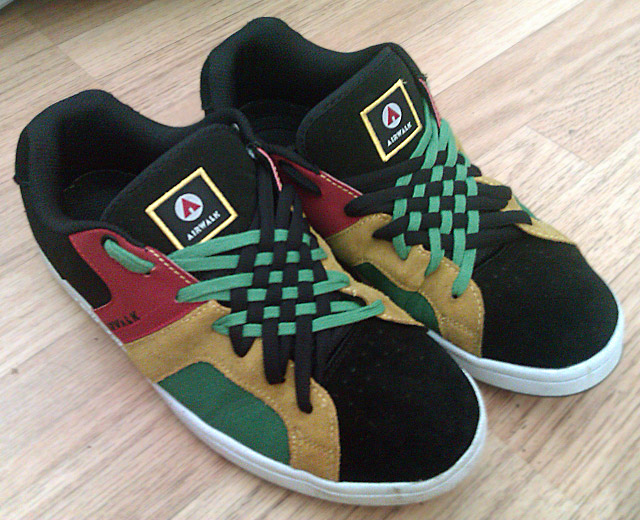 Black Airwalk sneakers with red, tan, green & white trim and green & black Angled Checker Lacing (from Neil O)
