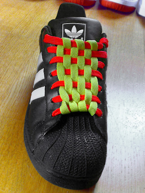 Black Adidas sneakers with white trim and fluoro orange & fluoro yellow Checkerboard Lacing (from Philip E)