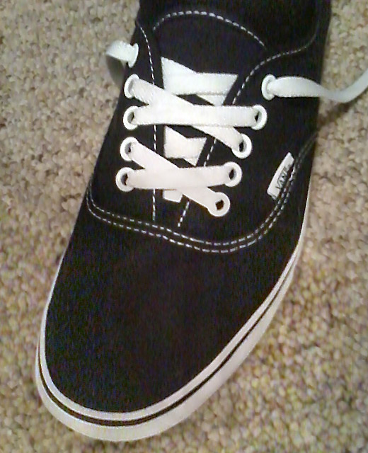 Black Vans sneakers with white trim and white Over Under Lacing (from Sebastian C)