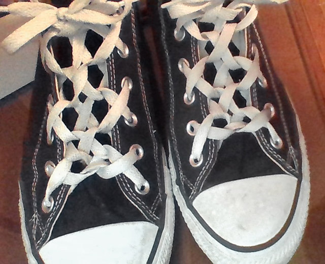 Black Converse All-Stars with white trim and white Woven Lacing (from Jacob G)