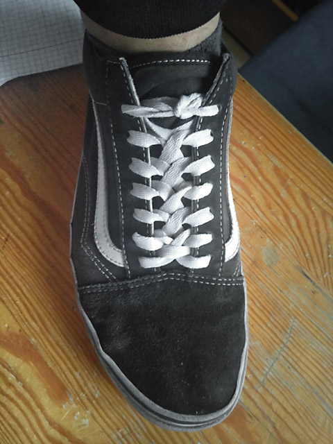 Black Vans sneakers with white trim and white Zipper Lacing (from Chris)