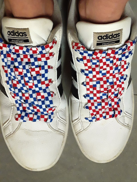White Adidas sneakers with black trim and red & white and blue & white Checkerboard Lacing (from Kristi I)