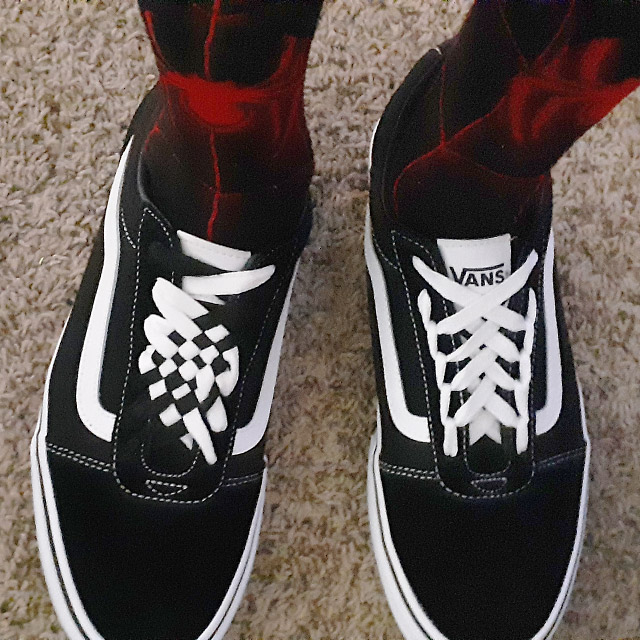 Black Vans sneakers with white trim and white combination of Angled Checker Lacing and Spider Web Lacing (from Ryan P)